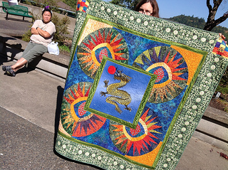 Marika Pineda shows off her Dragon Quilt