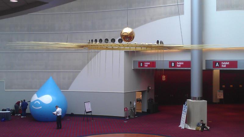 "The Drupal ""Drop"" under a pendulum at the Portland Convention Center"